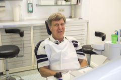 Man at the dentist. For a precaution session Stock Photos