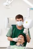 Man Dentist Preparing X-ray Stock Photography