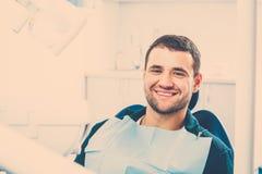 Man at dentist's surgery Royalty Free Stock Image