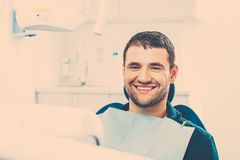 Man at dentist's surgery Royalty Free Stock Photos