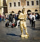 Man depicts a statue. PRAGUE, CZECH REPUBLIC - SEPTEMBER 30, 2017: man depicts a statue on the Prague street Stock Image