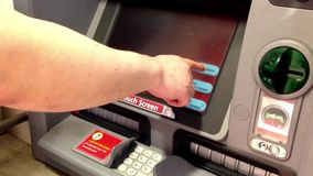 Man depositing cheque at ATM machine stock video footage