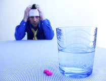 Man in depression. Man speculating on pill Royalty Free Stock Photography