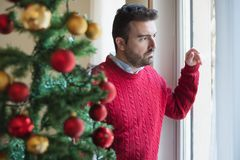 Sad man feeling bad during christmas days stock photography