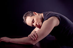 Man in depression over black ground Stock Photography