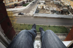 A man with depression sits on the window, wants to jump, suicide royalty free stock photo
