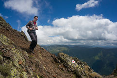 Man descending in the mountains. Man descending on a path in the mountains Royalty Free Stock Photos