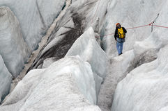 Man descends a glaicer. A man descends a glaicer in Iceland Royalty Free Stock Photos