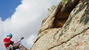 Man Descends from the top of the Cliff Royalty Free Stock Photography