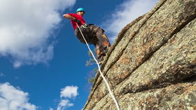 Man Descends from the top of the Cliff Royalty Free Stock Image