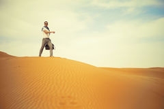 Man in desert. Fashionable man running through the desert Stock Images