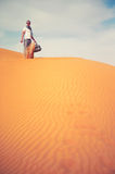 Man in desert. Fashion photo man standing in the desert Stock Photography