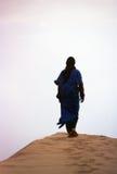 Man Desert. Bedouin walking on the dunes Royalty Free Stock Photos