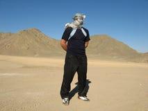 Man in desert with keffiyeh stock photography
