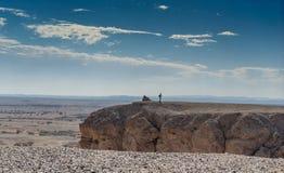 Man in a desert landscape of Israel. Travel in israeli arava desert under blue sky Stock Photo