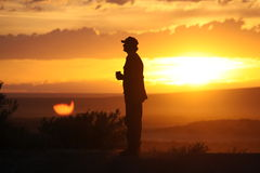 Man in Desert Sunset. A man in the desert at sunset royalty free stock photos