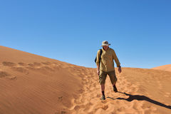 Man in desert Stock Images
