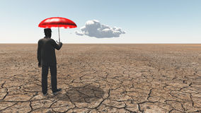 Man in desert with umbrella Royalty Free Stock Image