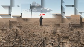 Man in desert with umbrella and single cloud Stock Image