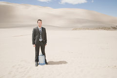 Man in desert with water bottle Royalty Free Stock Photo