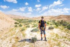 Man in desert wearing keffiyeh. Stock Photography
