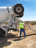 Man in Desert Working with Cement Truck - Vertical Stock Photo