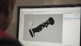Man design statue of woman in a computer programm. Imitation of turning lathe. Man design black statue of woman in a computer programm. Imitation of turning stock video