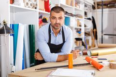 Man designer and print operator with paper print. At manufacturing royalty free stock images