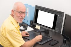 Man designer using graphics tablet for editing. A man designer using graphics tablet for editing stock images