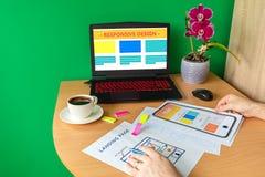 Man designing landing page website optimised for mobile – web designer hands sketching responsive modern website royalty free stock photography