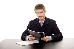 Man on a desk. Young man on a desk white isolate Royalty Free Stock Photo