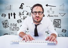 Man at desk against black business doodles and blurry grey wood panel Stock Photo