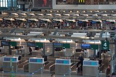 Man: the  desk  of check in  Malpensa airport. Milan, a view of desk check-in at  Malpensa airport Stock Image