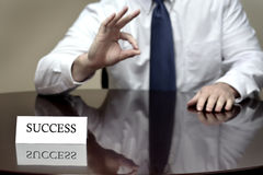 Man Desk Hands Gesturing Success OK. Man at dest with hands gesturing success ok sign Royalty Free Stock Images