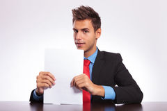 Man at desk looks at you Stock Image