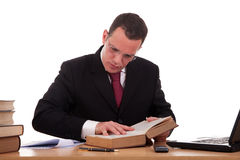 Man on desk reading and studying Royalty Free Stock Images