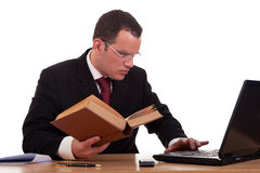 Man on desk reading and studying, Royalty Free Stock Photo