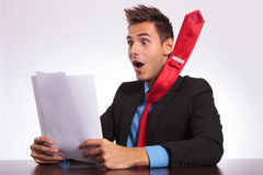 Man at desk reads spectacular news Royalty Free Stock Photography