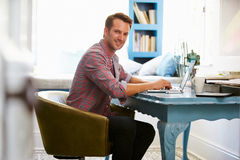 Man At Desk Working In Home Office With Laptop stock image