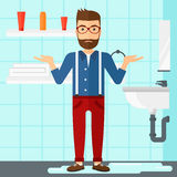 Man in despair standing near leaking sink. Stock Images