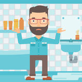 Man in despair standing near leaking sink. Stock Image