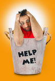 Man with a desperate expression in wooden bucket. Stock Image