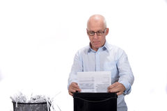 Man destroyed documents to the mill Stock Photos