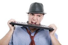 Man destroying keyboard Stock Images