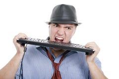 Man destroying keyboard Stock Images