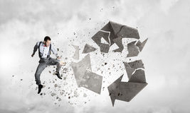 Man destructing recycle symbol royalty free stock photo
