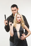 Man detective agent criminal and sexy spy woman with gun. Royalty Free Stock Image