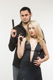 Man detective agent criminal and sexy spy woman with gun. Royalty Free Stock Images