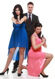 Man detective secret agent criminal with two women gun Stock Images