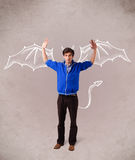 Man with devil horns and wings drawing Royalty Free Stock Photos
